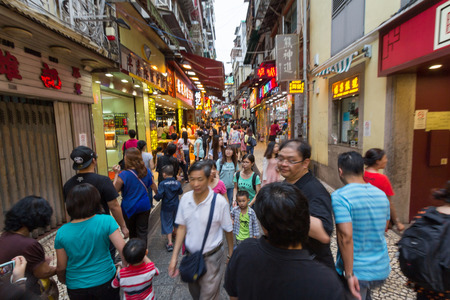 tourism industry: Crowded streets in Macau  Chinese tourists are the main resource in macau tourism industry now  Editorial