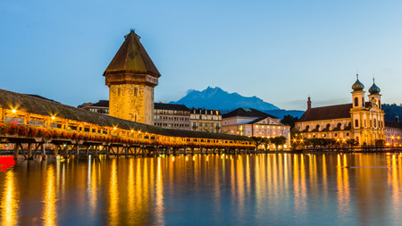 Chapel bridge at night in Lucerne, Switzerland photo