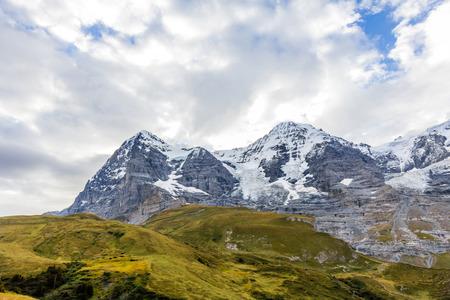 monch: View of Eiger, Monch and Jungfrau massif from Kleine Scheidegg railway station on Swiss Alps, Switzerland, Europe