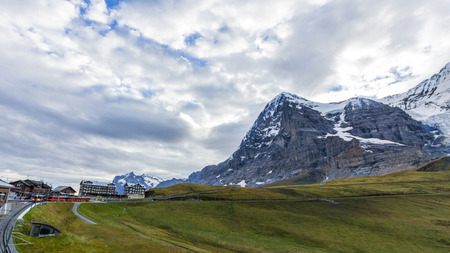 View of Eiger, Monch and Jungfrau massif from Kleine Scheidegg railway station on Swiss Alps, Switzerland, Europe photo