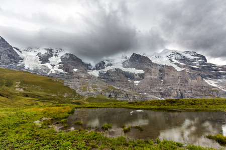 monch: Reflection of Eiger, Monch and Jungfrau, Switzerland, Europe