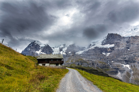 An isolated house in a beautiful landscape photo