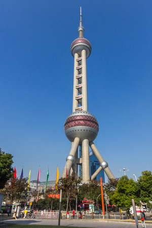 pudong district: The Oriental Pearl is a TV tower in Shanghai, China. It is located at the tip of Lujiazui in the Pudong district by the side of Huangpu River, opposite The Bund.