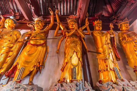 jade buddha temple: Buddhist Statues at Jade Buddha temple in Shanghai, China. It houses two jade Buddha statues which had been brought from Burma by a monk named Huigen. Editorial