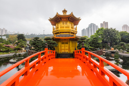 garden features: The Golden Pavilion of Perfection in Nan Lian Garden, Hong Kong. It is designed in the Tang Dynasty-style with hills, water features, trees, rocks and wooden structures.