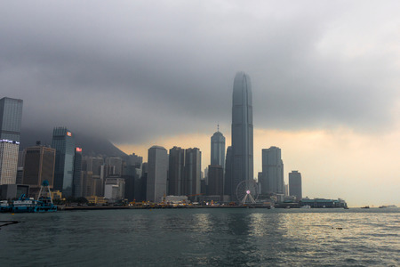 taller: View of modern skyscrapers in downtown Hong Kong, China. Hong Kong is an international financial center that has 112 buildings that stand taller than 180 meters