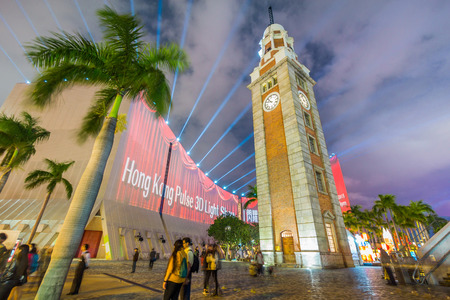 three dimensions: The Clock Tower in Tsim Sha Tsui, Kowloon, Hong Kong in Night. It is the only remnant of the original site of the former Kowloon Station on the Kowloon-Canton Railway. Editorial