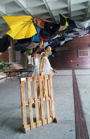 broken unity: A statue of a wooden man holding an umbrella, the symbol of the pro-democracy Umbrella Revolution, stands in the Hong Kong Polytechnic University. Editorial