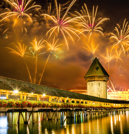 Fireworks over Chapel bridge in Lucerne, Switzerland