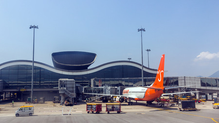 Jeju Air flight in Hong Kong International Airport. About 90 airlines operate flights from HKIA to over 150 cities across the globe. Editorial