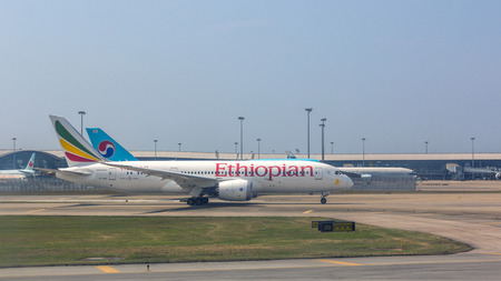 Ethiopian Airlines flight in Hong Kong International Airport. About 90 airlines operate flights from HKIA to over 150 cities across the globe. Editorial