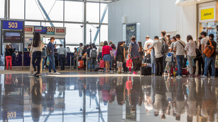 queue: People queued up for boarding to flight to Shanghai in Hong Kong International airport.