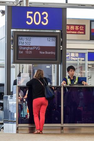 A passenger waiting at the departure terminal in Hong Kong international airport.