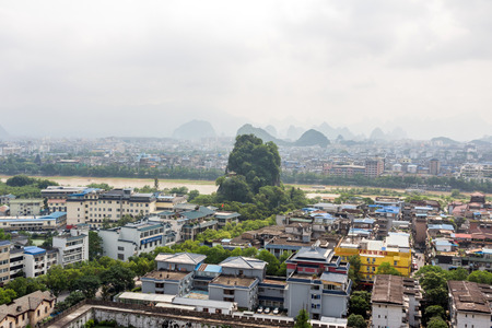 subduing: View of Fubo hill and Li river from the top of Solitary Beauty Peak in Jingjiang Prince City. Fubo Shan carries Xinxi Marquis Temple built during the Tang Dynasty.