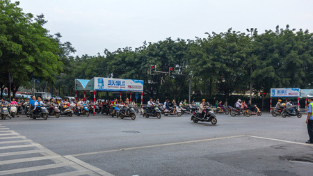 A street scene in Guilin China. Motor bikes are the most popular medium of transportation in Guilin.