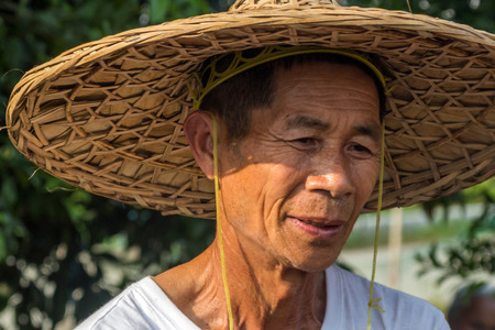 chinese adult: An unidentified old farmer in Yangshuo China.