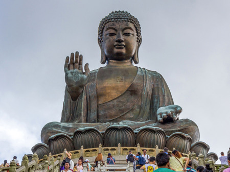 Tian Tan Buddha aka the Big Buddha is a large bronze statue of a Sakyamuni Buddha and located at Ngong Ping Lantau Island in Hong Kong. Editorial