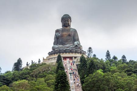 lantau: Tian Tan Buddha aka the Big Buddha is a large bronze statue of a Sakyamuni Buddha and located at Ngong Ping Lantau Island in Hong Kong. Stock Photo