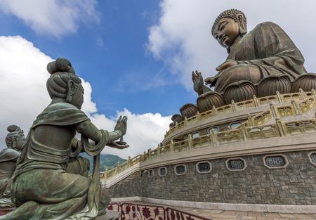 chinese buddha: Tian Tan Buddha aka the Big Buddha is a large bronze statue of a Sakyamuni Buddha and located at Ngong Ping Lantau Island in Hong Kong. Stock Photo