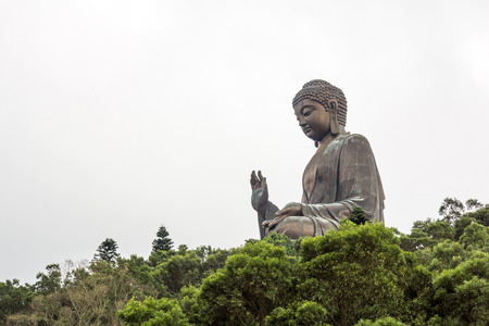 big buddha: Tian Tan Buddha aka the Big Buddha is a large bronze statue of a Sakyamuni Buddha and located at Ngong Ping Lantau Island in Hong Kong. Stock Photo
