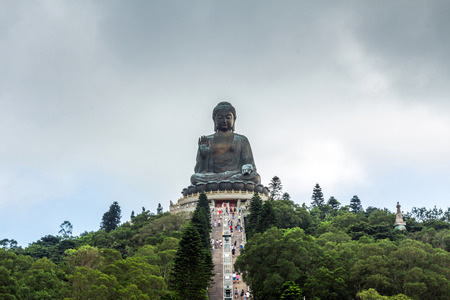 Tian Tan Buddha aka the Big Buddha is a large bronze statue of a Sakyamuni Buddha and located at Ngong Ping Lantau Island in Hong Kong. Stock Photo