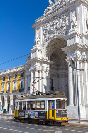 presently: Vintage tram 28 in Praca Do Comercio in Lisbon Portugal. The Lisbon tramway network operates since 1873 and presently comprises five urban lines.
