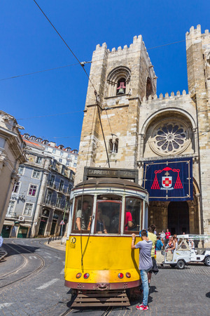 presently: Vintage tram 28 in Alfama district in Lisbon Portugal. The Lisbon tramway network operates since 1873 and presently comprises five urban lines.