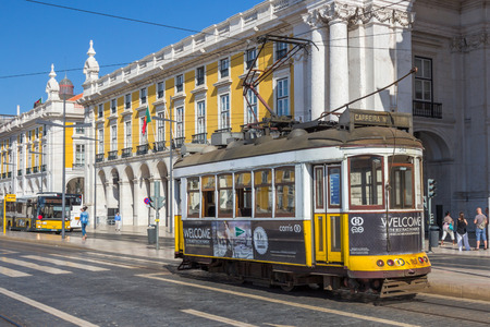 electrico: Vintage tram 28 in Praca Do Comercio in Lisbon Portugal. The Lisbon tramway network operates since 1873 and presently comprises five urban lines.