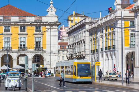 presently: A modern tram in Lisbon, Portugal. The Lisbon tramway network operates since 1873 and presently comprises five urban lines.