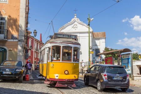 electrico: A vintage tram in Largo das Portas do Sol in Lisbon Portugal. The Lisbon tramway network operates since 1873 and presently comprises five urban lines. Editorial