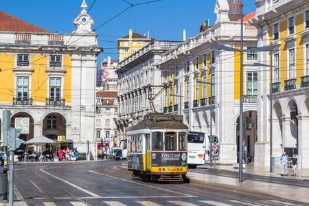 electrico: Vintage tram 28 in Praca Do Comercio in Lisbon Portugal.