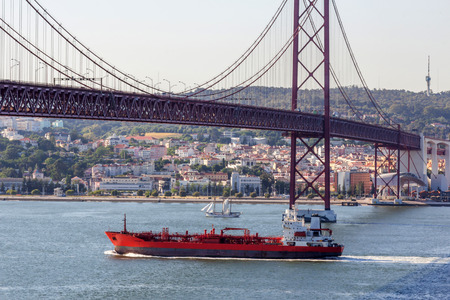breadth: A ship traveling under 25 de Abril Bridge in Lisbon, Portugal