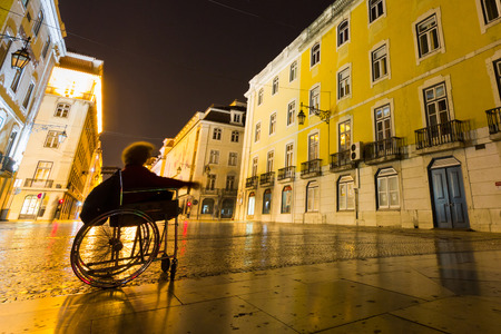 augusta: A disable lady begging in Rua Augusta, aka Augusta street. Editorial