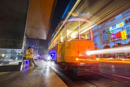 electrico: A vintage tram in Praca Do Comercio in Lisbon, Portugal.
