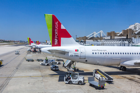 headquartered: TAP Portugal flight preparing for departure. It is the flag carrier airline of Portugal, headquartered at Lisbon Portela Airport which also serves as its hub. Editorial
