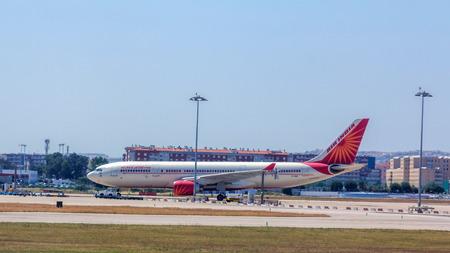 to depart: Air India flight preparing to depart from Lisbon Portela Airport in Lisbon.