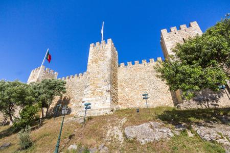 jorge: Lisbon and Portuguese Flags waving on Sao Jorge Castle in Lisbon Portugal