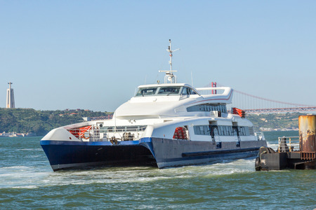 the tagus: A yatch in Tagus river, Lisbon, Portugal Editorial