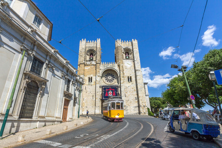 electrico: Vintage tram 28 in Alfama district in Lisbon, Portugal. The Lisbon tramway network operates since 1873, and presently comprises five urban lines.