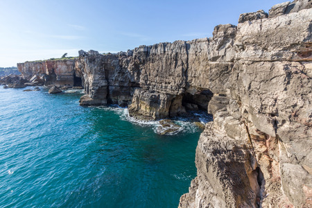 rock cliff: Cabo da Roca Cape Roca  lighthouse and cliffs.