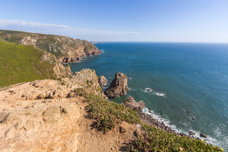 roca: Seaside cliffs in Cabo da Roca. It is a cape which forms the westernmost extent of mainland Portugal and continental Europe.