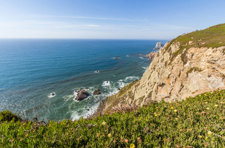 extent: Seaside cliffs in Cabo da Roca. It is a cape which forms the westernmost extent of mainland Portugal and continental Europe.
