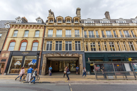 the existing: The Grand Arcade. It is a large shopping centre in St Andrews Street, Cambridge, England. It links to the existing Lion Yard shopping centre. Editorial