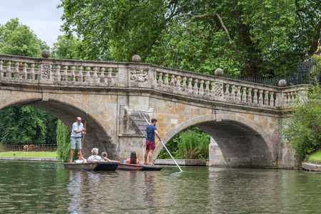 Punting in summer on the river Cam. There are several companies on the Cam operating tours and hiring punts to visitors.