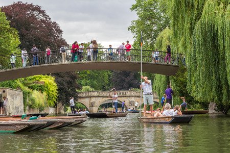 punting: Garret Hostel Lane and Clare college bridge over river Cam. Punting is one of the main outdoor activities in summer in Cambridge, England.