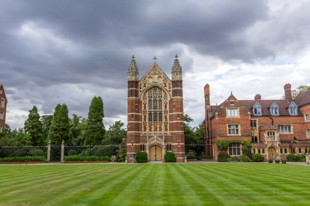 constituent: Selwyn College chapel and other college buildings. It is a constituent college in the University of Cambridge in England, founded by the Selwyn Memorial Committee.