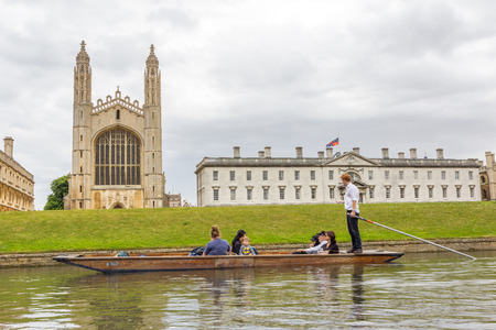 Punting in summer on the river Cam with the view of Kings College of the University of Cambridge in the background.
