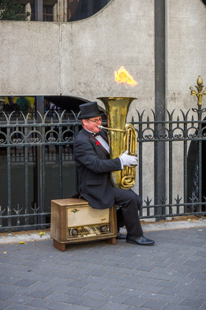 travelled: Christopher Werkowicz, a street performer from Poland who has travelled around Europe with his musical Fire Tuba, performs in London, UK. Editorial
