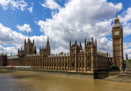 commons: UK Parliament next to Thames river in London, England