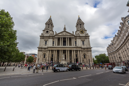 typically english: Front view of St Pauls Cathedral, a Popular tourist location in London. It sits on Ludgate Hill at the highest point of the City of London.